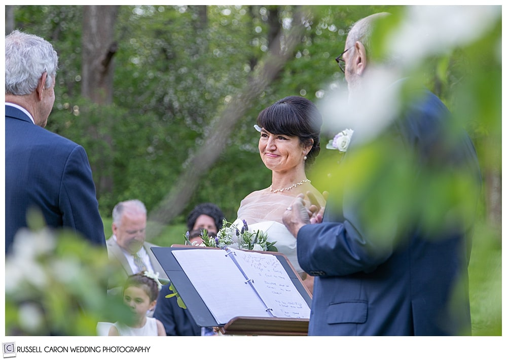 photo of the bride during an outdoor wedding ceremony