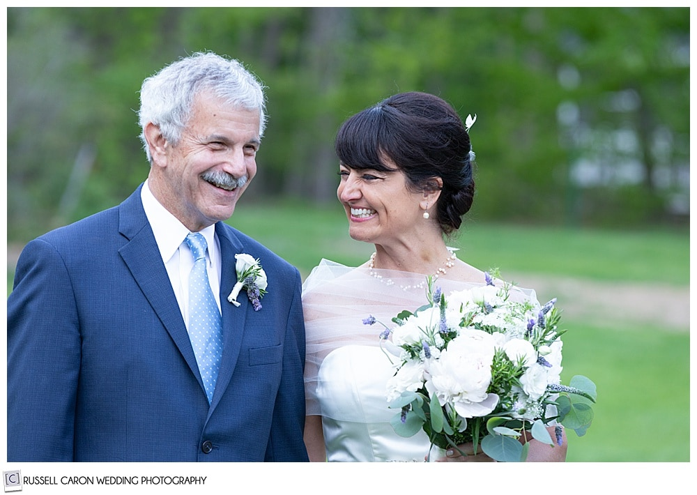 bride smiling at the groom during their intimate Cape Neddick wedding ceremony