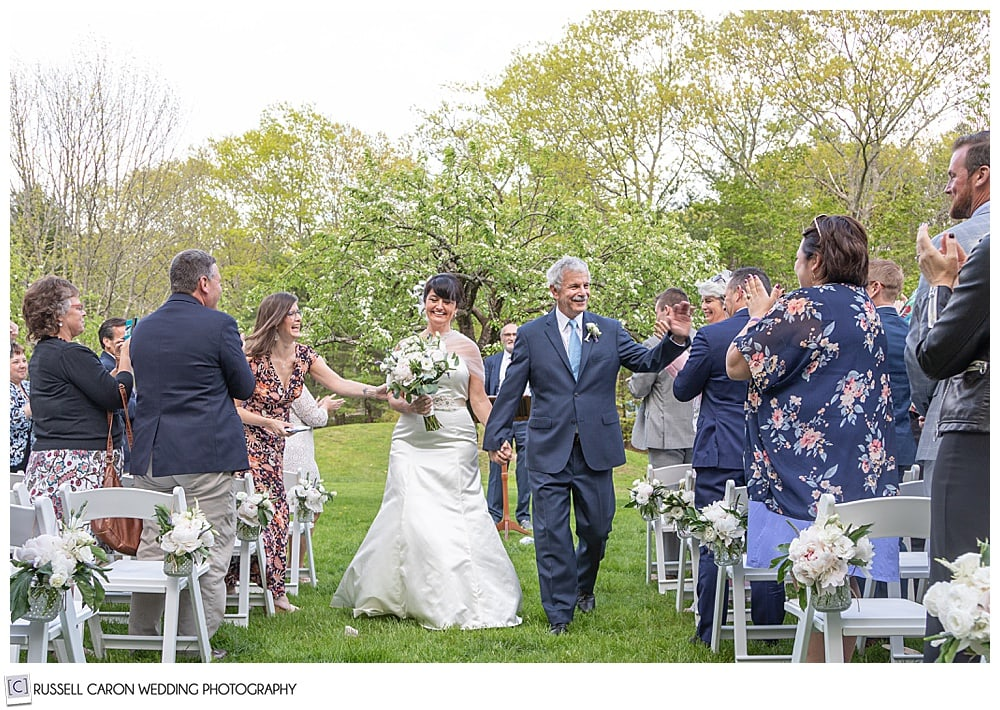 bride and groom during their recessional at their intimate cape neddick wedding ceremony