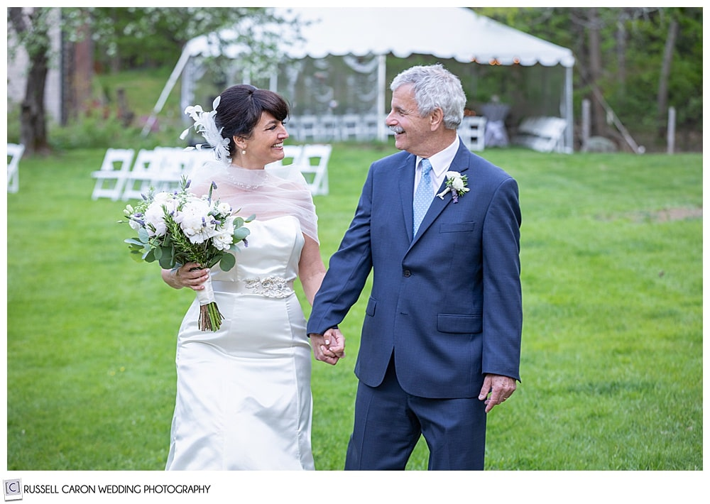 bride and groom walking and talking together