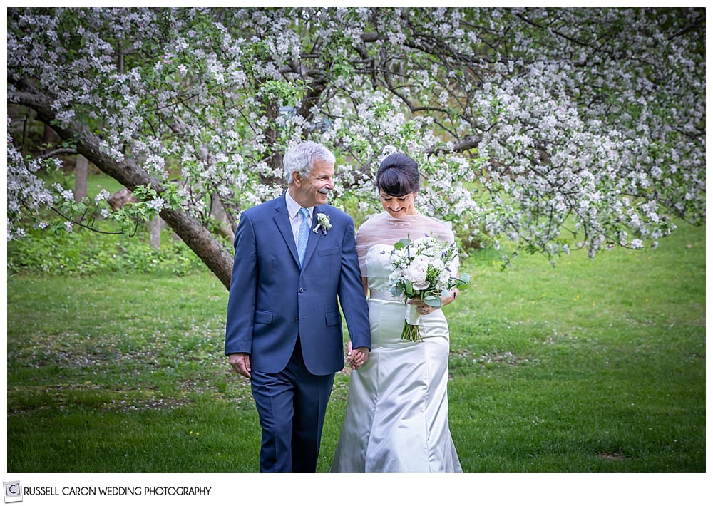 bride and groom walking together holding hands
