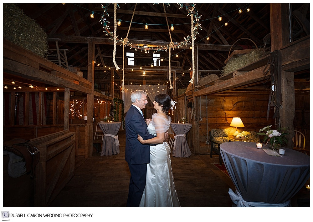 ride and groom dancing in a barn