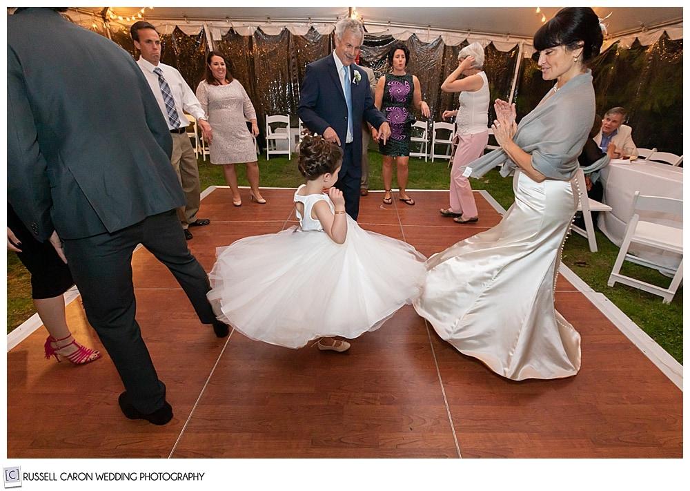 flower girl twirling on the dance floor
