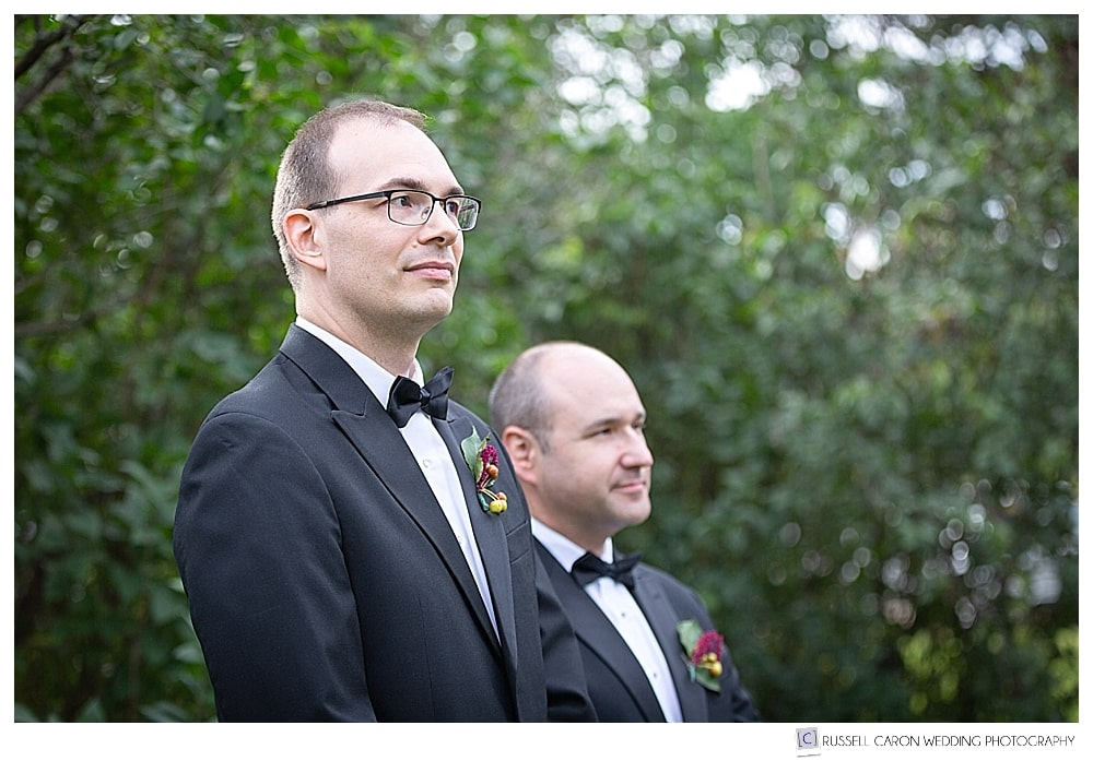 Groom and best man wait for the bride to come down the aisle