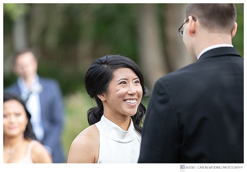 photo of bride smiling at groom