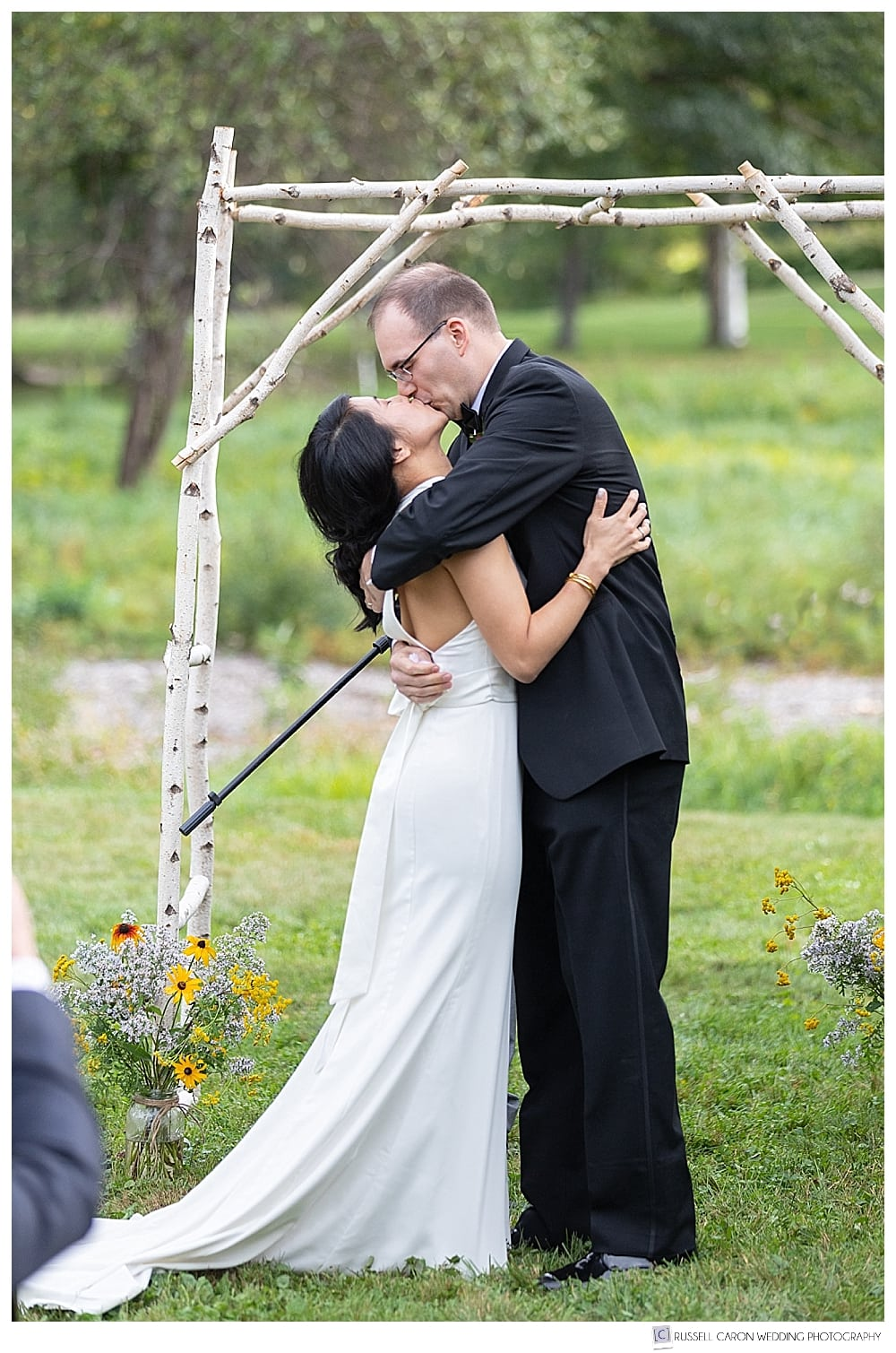 bride and groom's first kiss photo