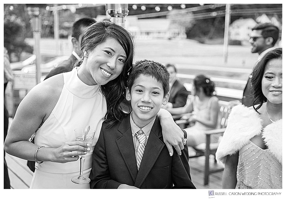 black and white photo of bride and young guest