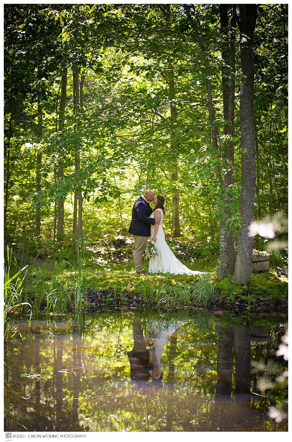 bride-and-groom-reflected-in-pond