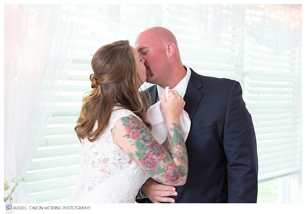 bride-and-groom-share-a-kiss