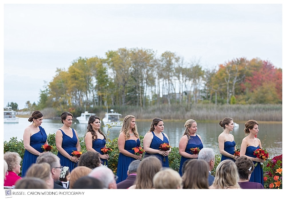 bridesmaids during wedding ceremony on Nonantum Resort lawn