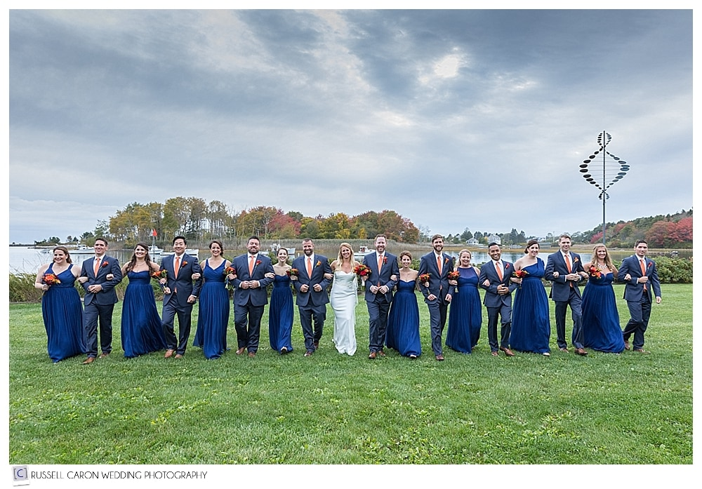 wedding party arm in arm at the Nonantum Resort Kennebunkport Maine