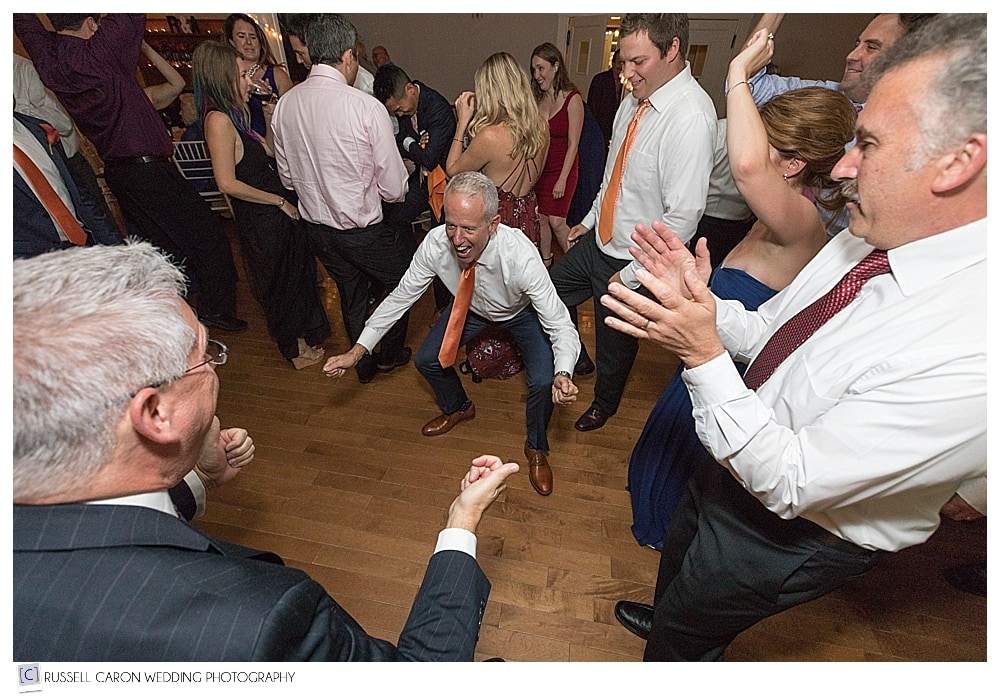father of the bride dancing at wedding reception