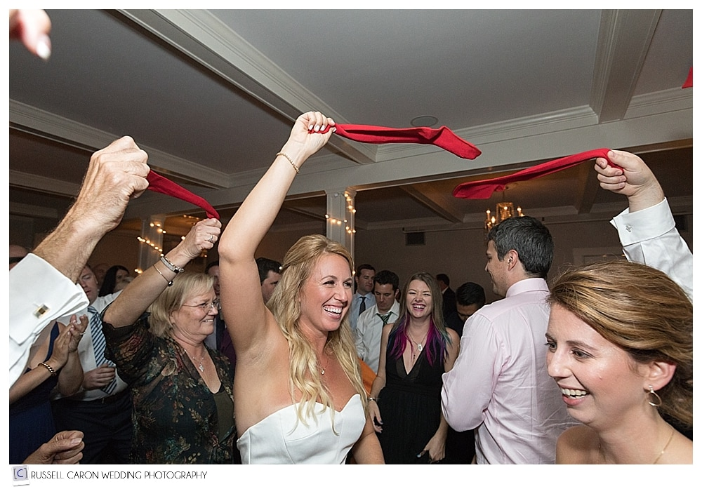 bride dancing with red socks