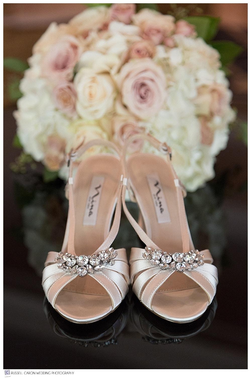 Bride's shoes and bouquet detail photo