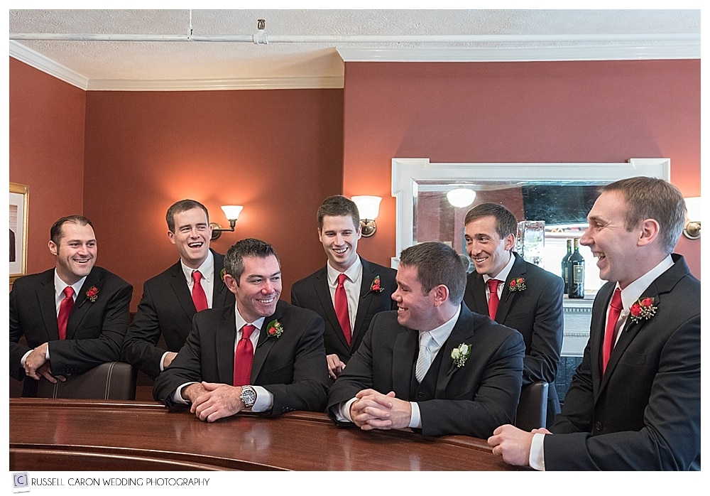 groom and groomsmen at the bar