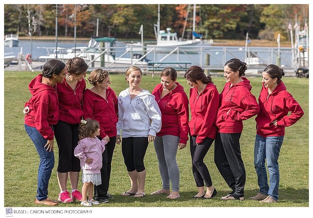 bride and bridesmaids in red sweatshirts