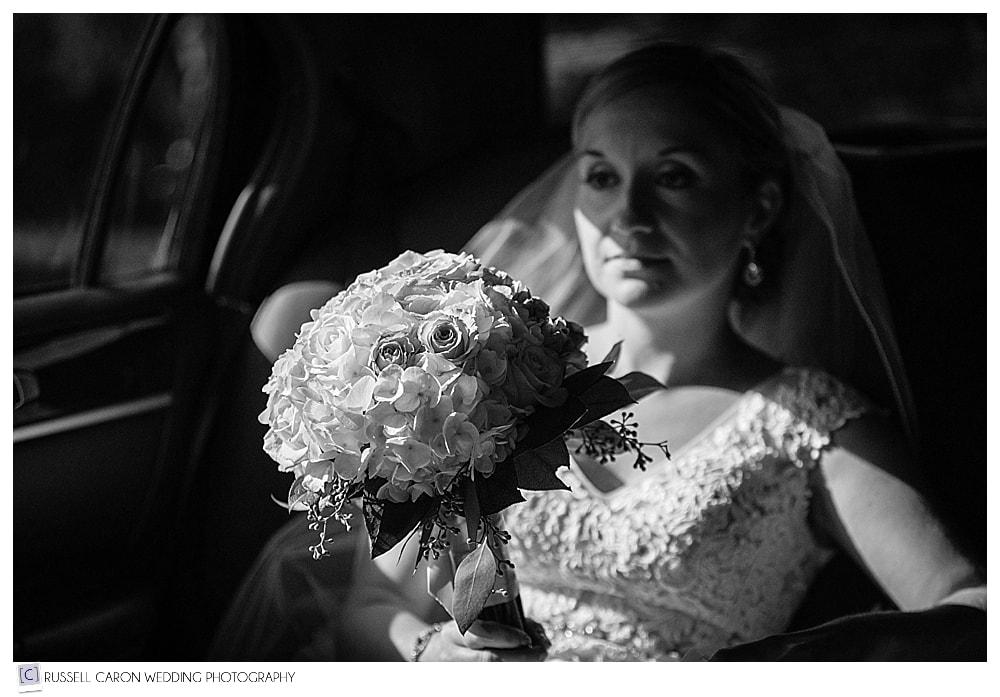 bride riding in limousine