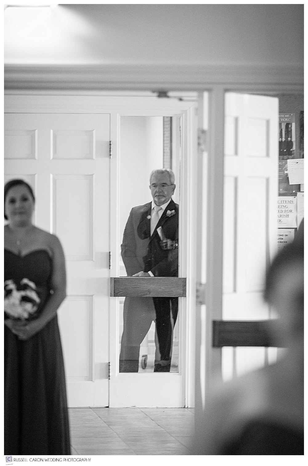 father of the bride watching processional