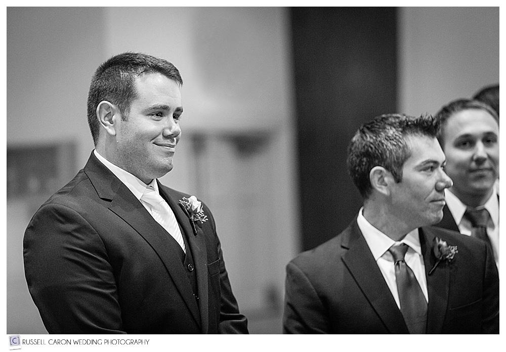 groom watching bride approach