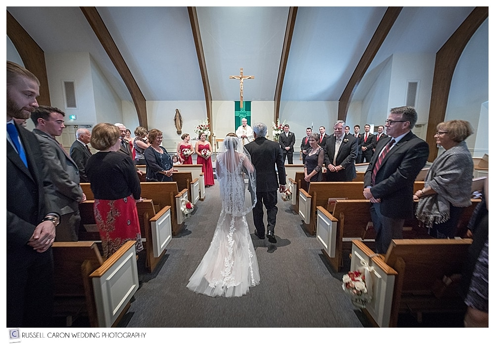 bride and her father as they approach the altar
