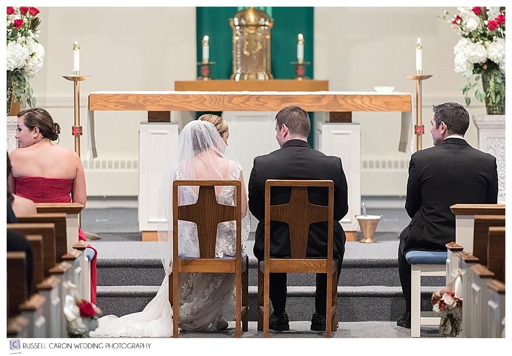 bride and groom during catholic wedding ceremony