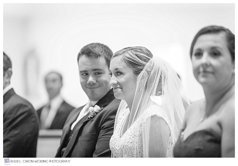 groom watching bride during wedding ceremony
