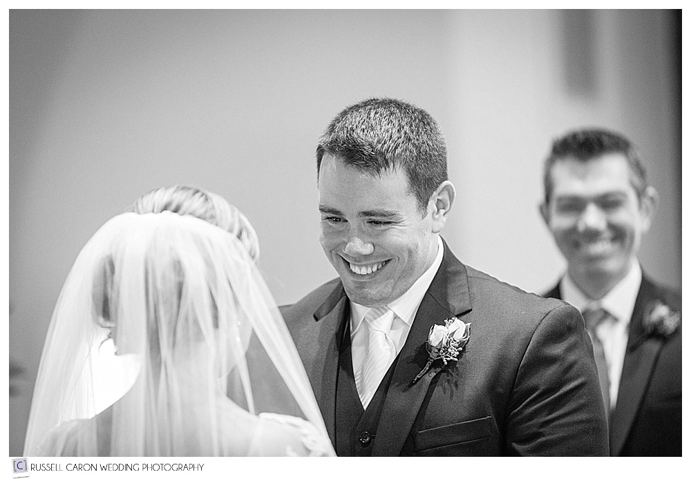groom smiling at bride during exchange of vows
