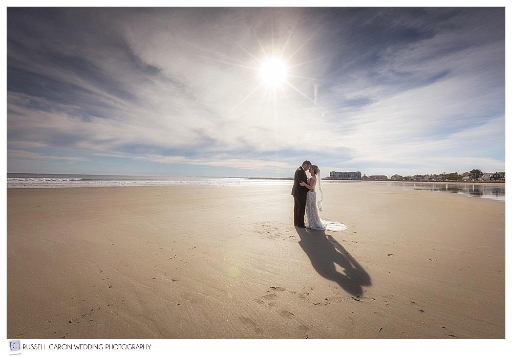 bride and groom kissing on Gooch's Beach Kennebunk Maine