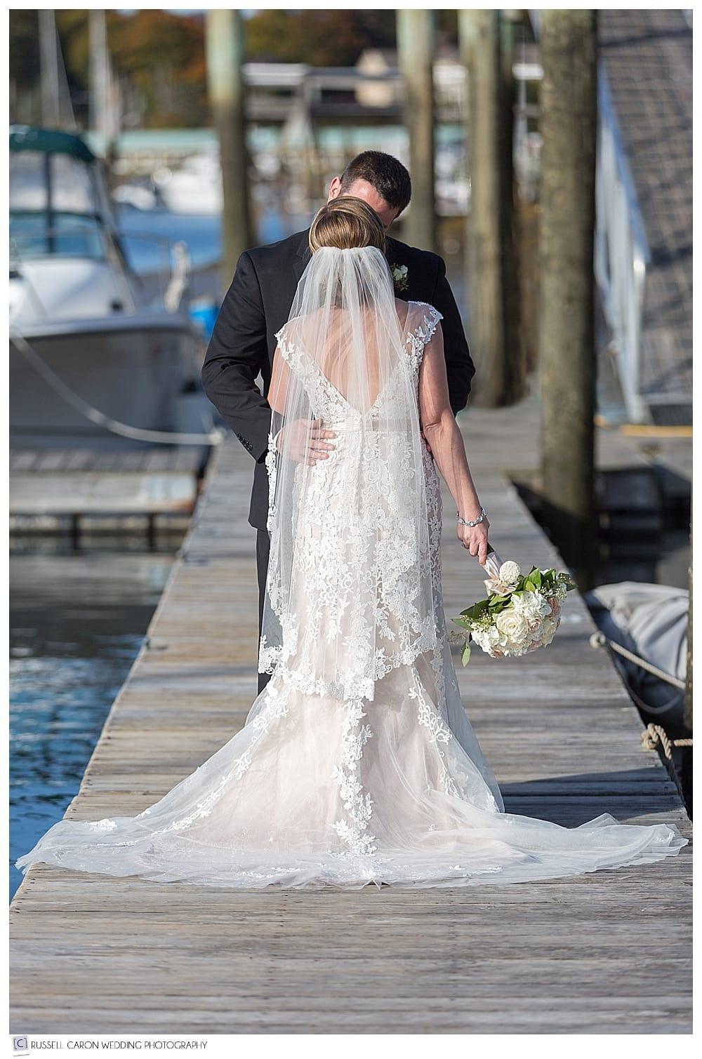 bride and groom on the nonantum resort dock