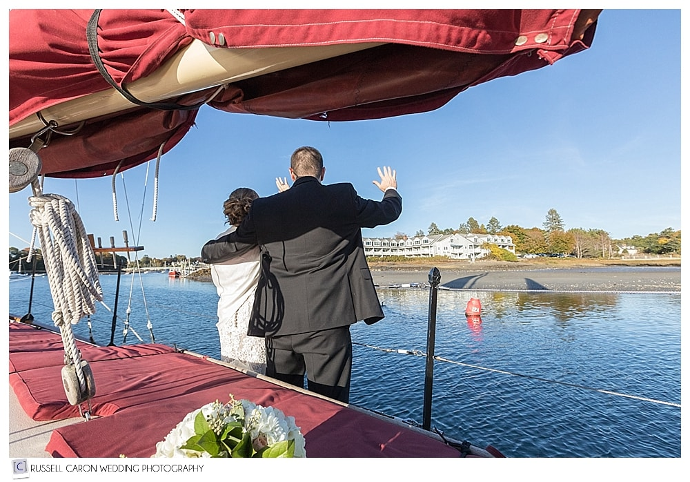 bride and groom on boat waving to nonantum guests