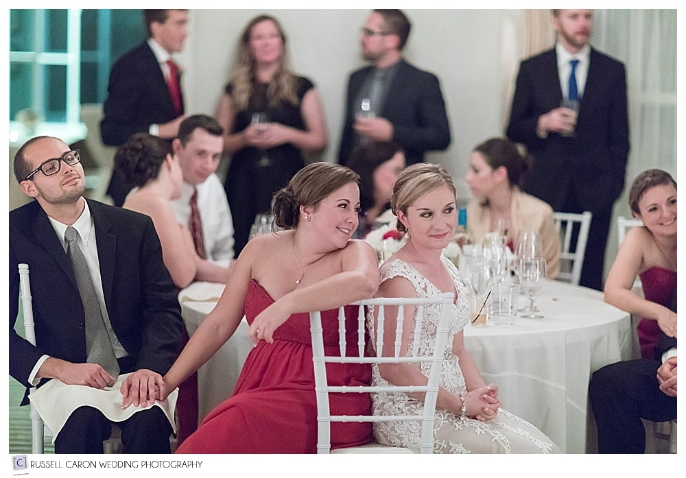 bride and maid of honor sitting together