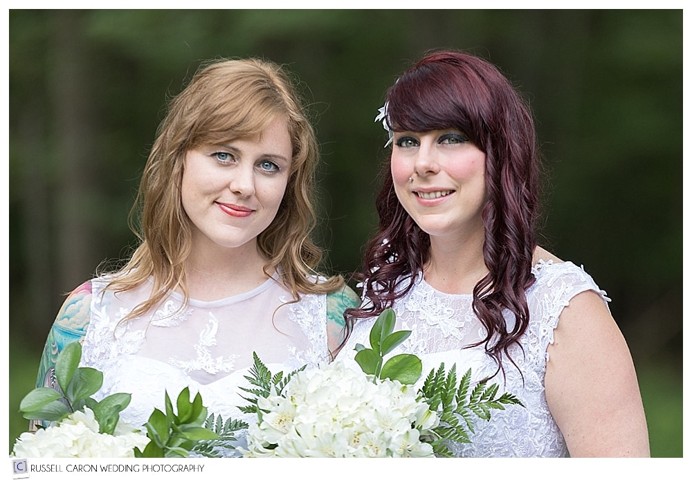 two brides standing together