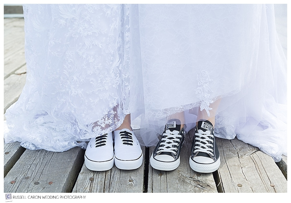 brides wearing black and white sneakers
