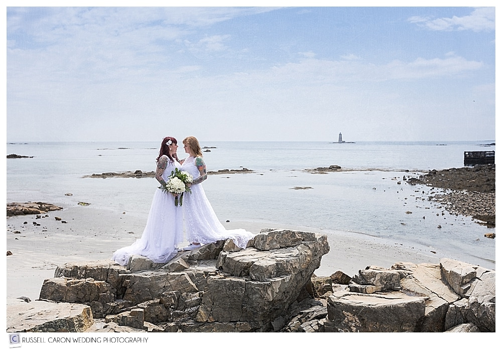 brides kissing on the rocks at Fort Foster, Kittery Maine wedding