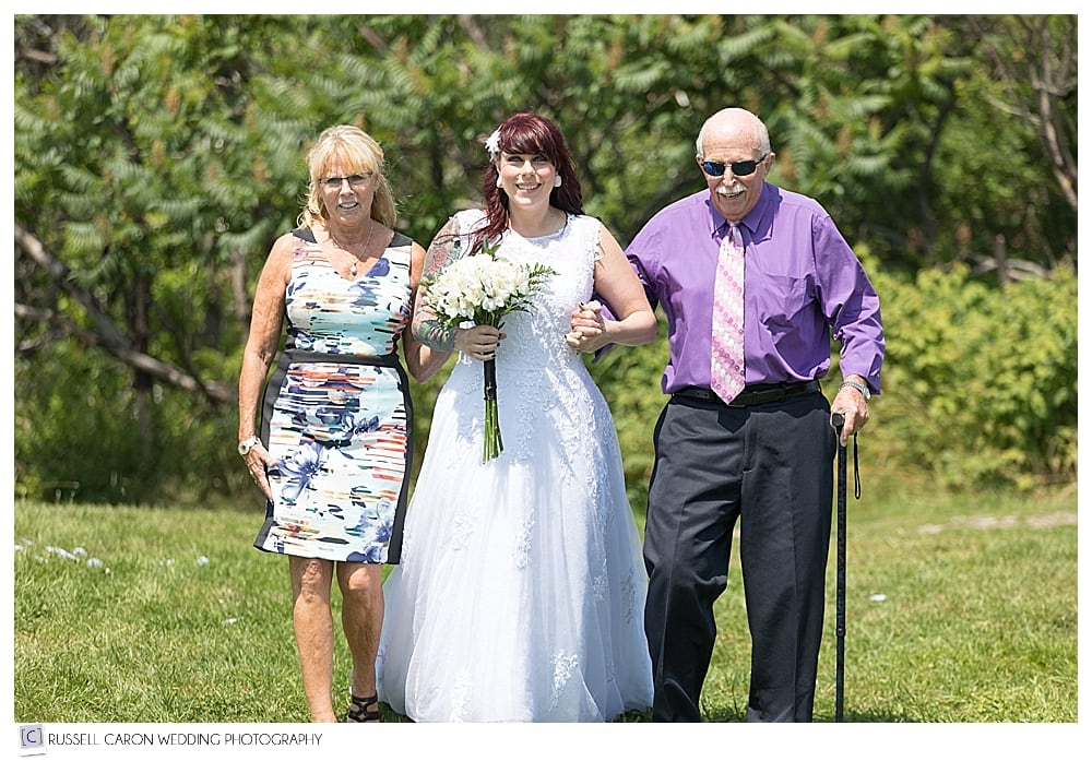 bride escorted by her mother and grandfather