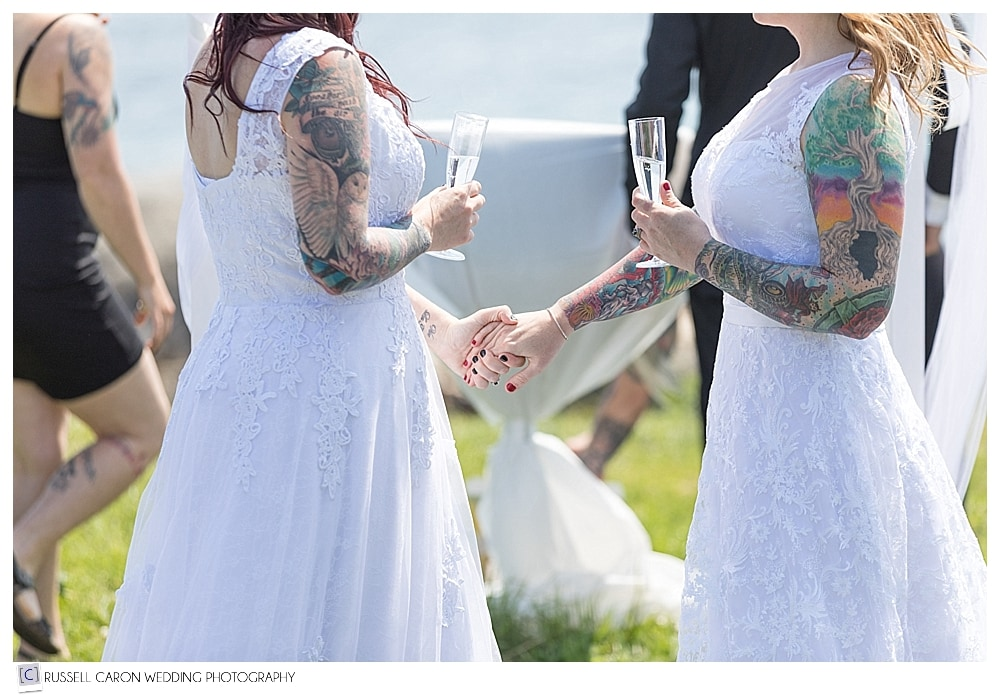 brides holding hands during wedding ceremony