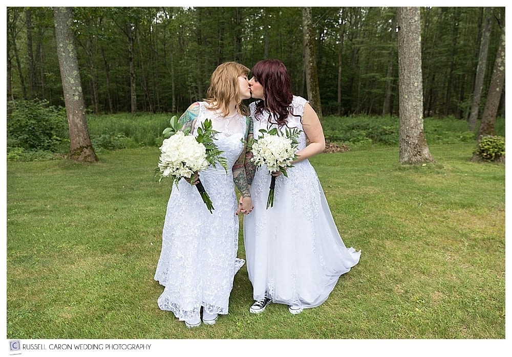 brides kissing after their wedding day first look