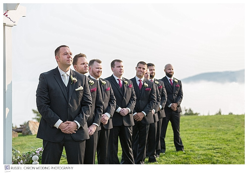 groom and groomsmen standing at the arbor at Point Lookout wedding