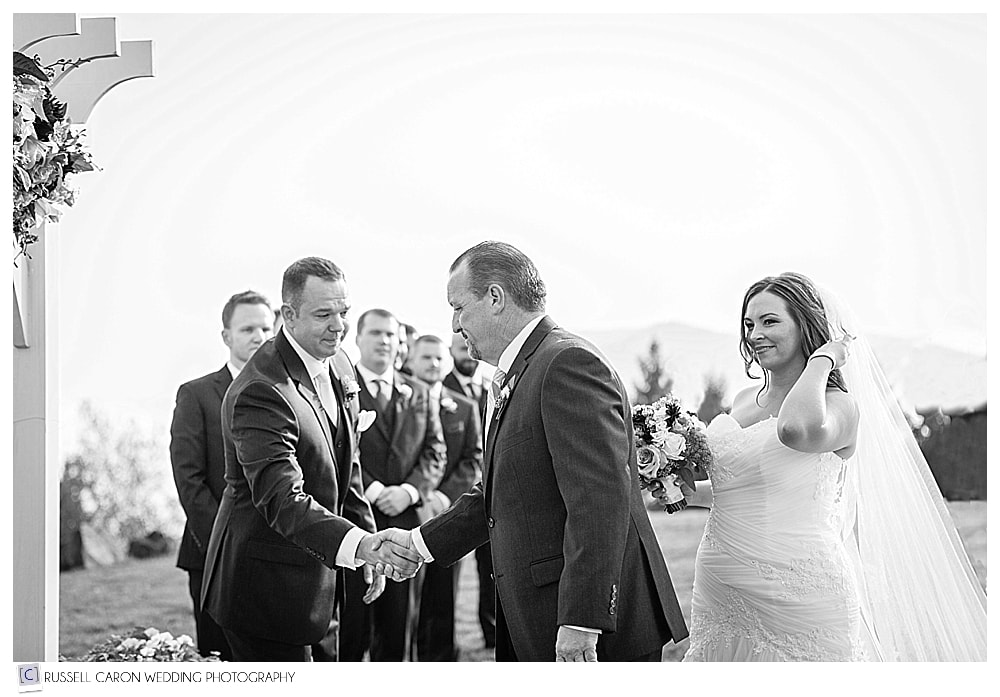 father of the bride shakes the grooms hand at the arbor at Point Lookout
