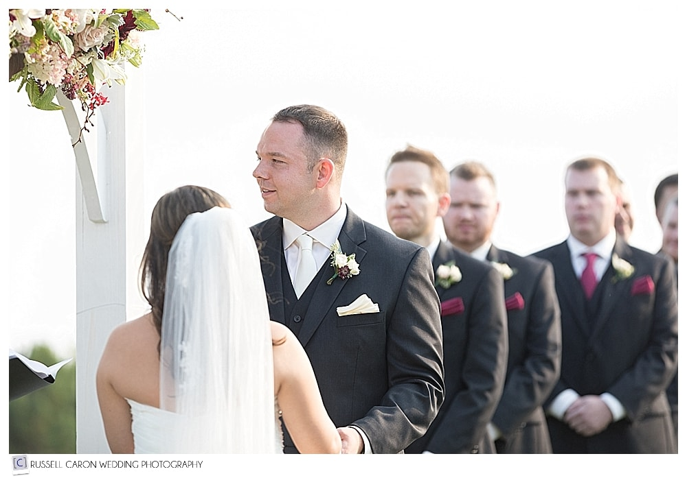 groom during outdoor wedding ceremony at Point Lookout