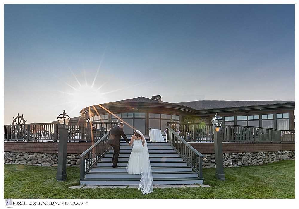 bride and groom walking up the steps to their Point Lookout wedding reception