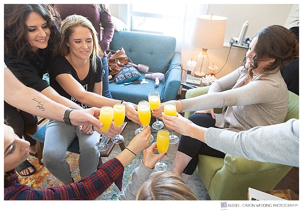 women toasting with mimosas