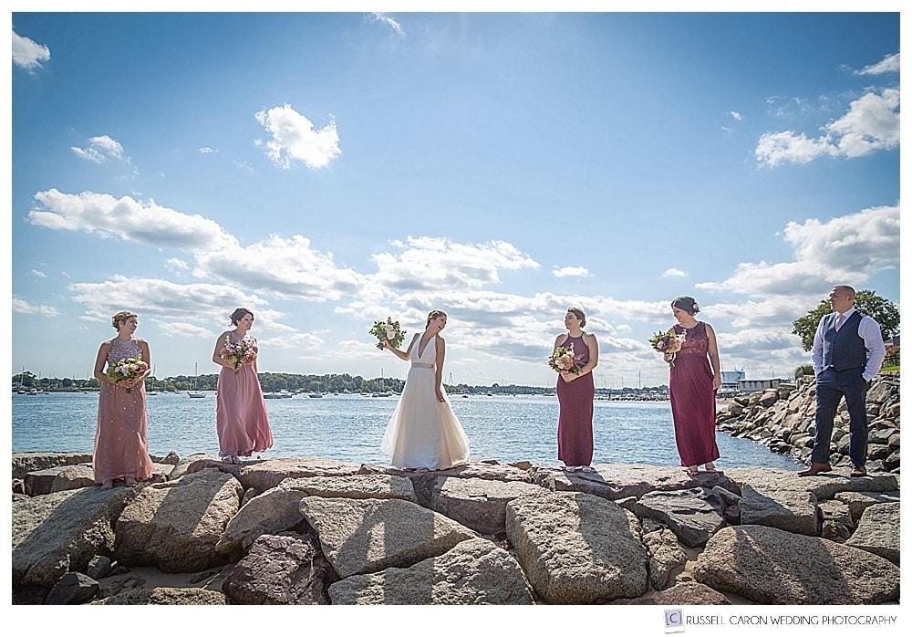 bride, bridesmaids, and bridesman on a jetty in Beverly, MA