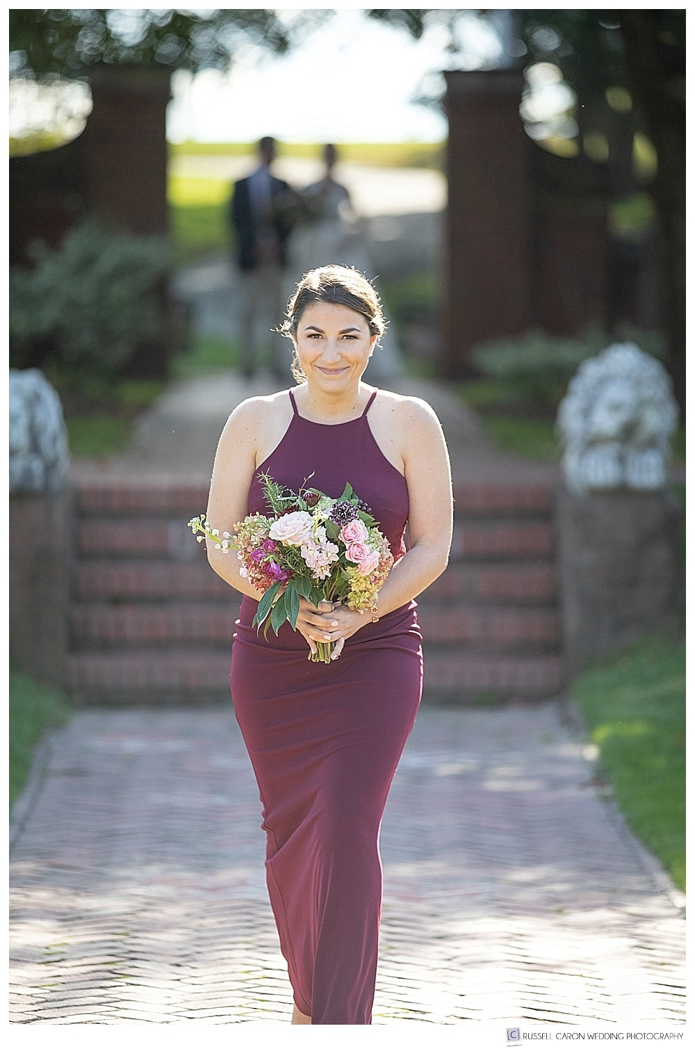 bridesmaid in burgundy colored dress
