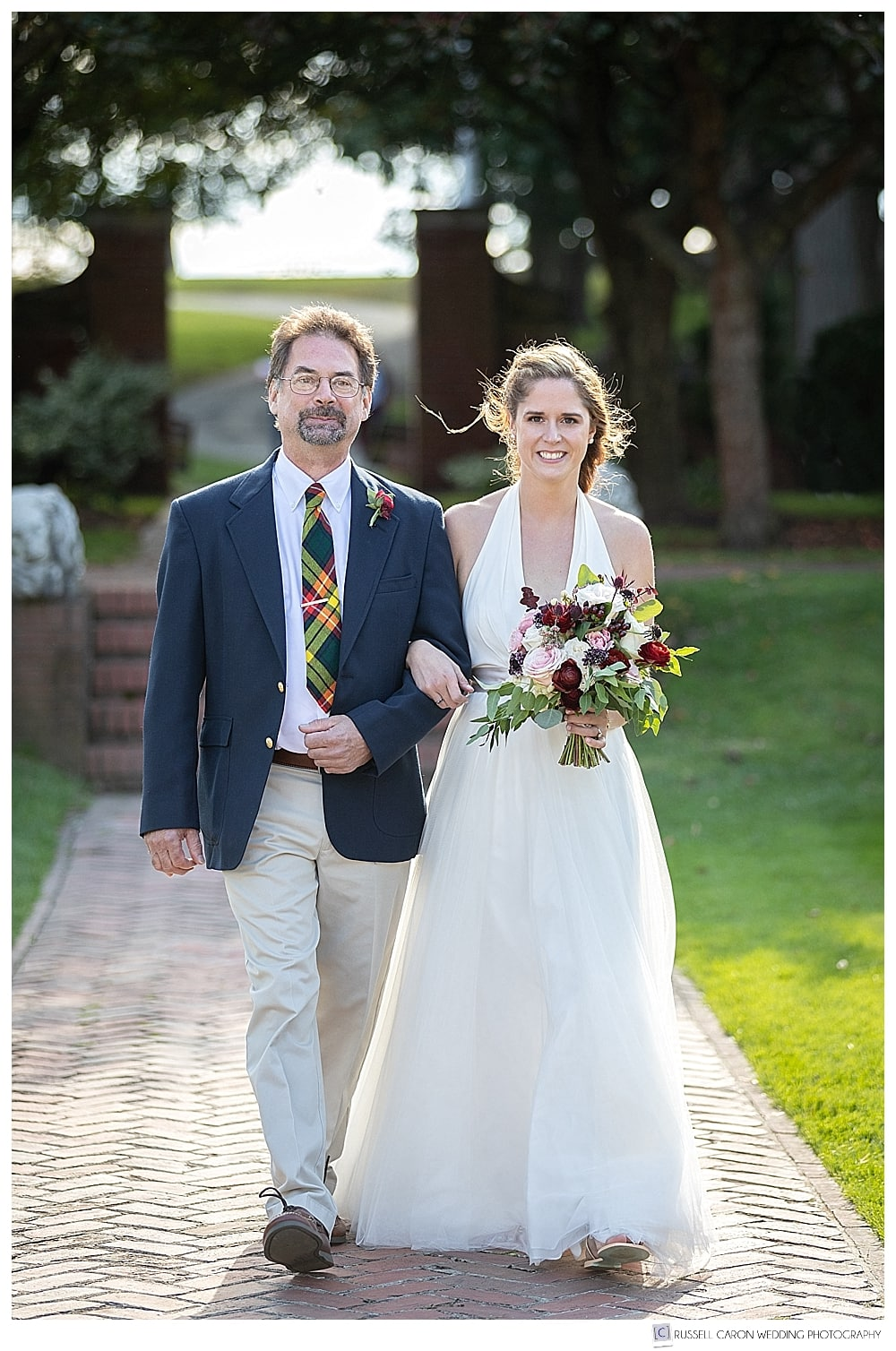 bride and her father walking down the aisle during Rose Garden Lynch Park wedding ceremony