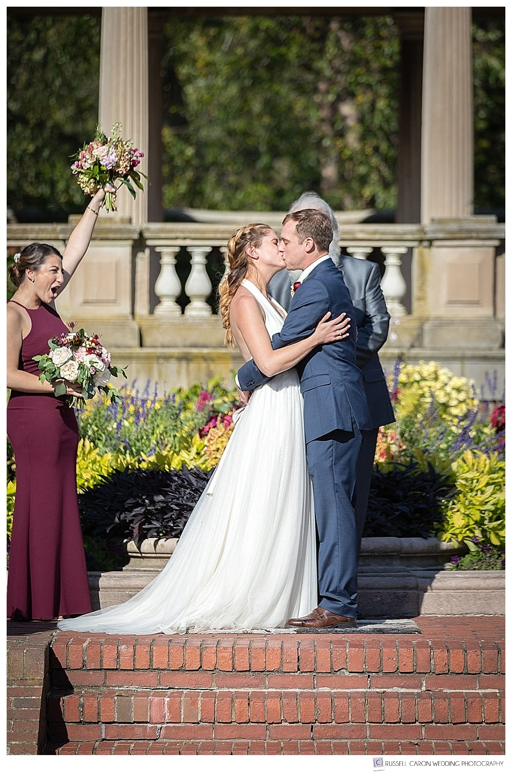 bride and groom's first kiss in the Rose Garden at Lynch Park, Beverly, MA