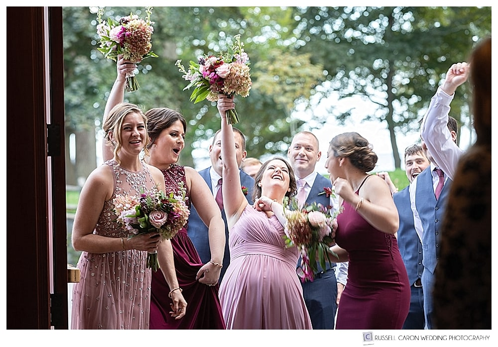 bridal party cheering while being announced in to wedding reception
