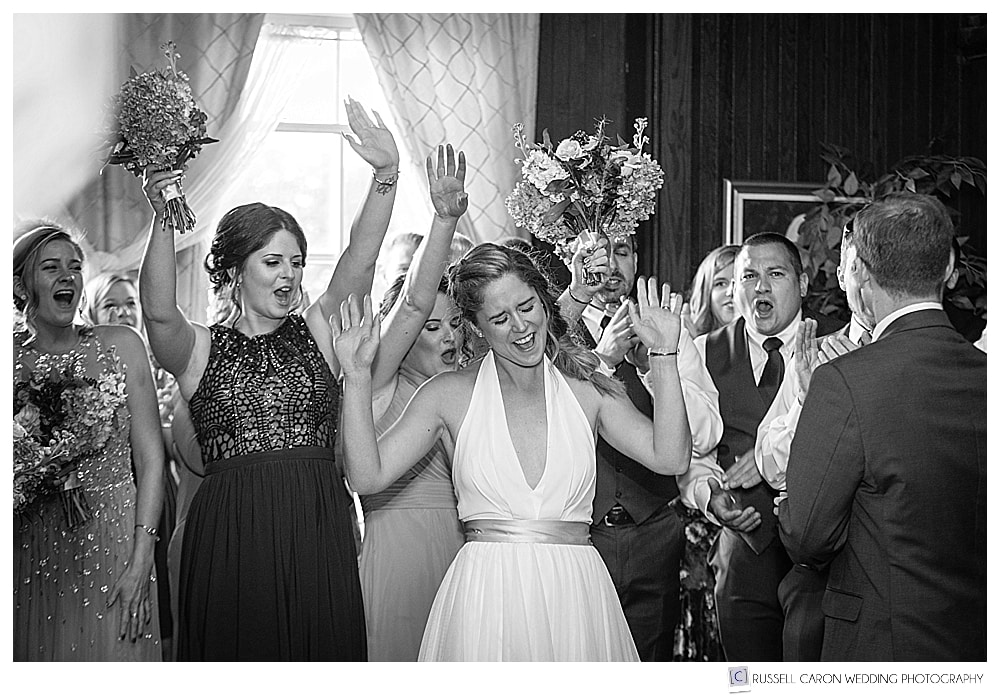 black and white photo of bride as she and her groom are announced in to their Lynch Park wedding reception