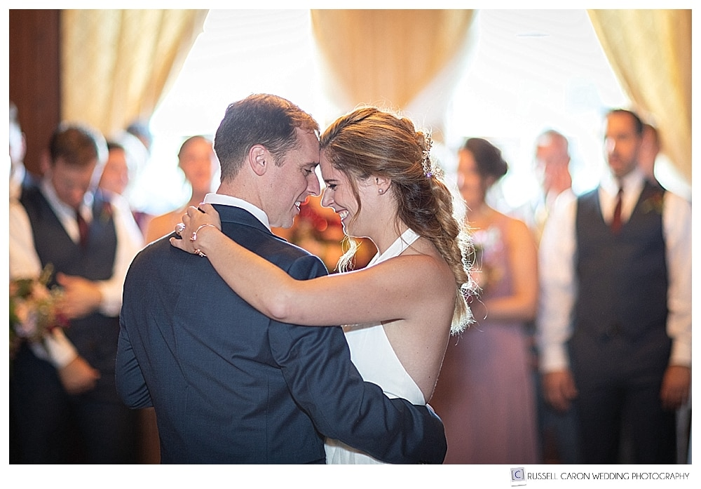 bride and groom touching foreheads together during their first dance