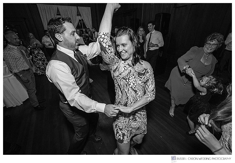 Black and white photo of man and woman dancing